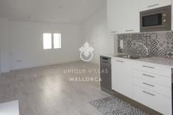 uniquevillasmallorca reformed flat for sale in Palma center kitchen:living area